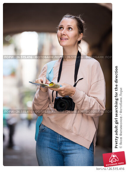 Купить «Pretty adult girl searching for the direction», фото № 26515416, снято 4 мая 2017 г. (c) Яков Филимонов / Фотобанк Лори
