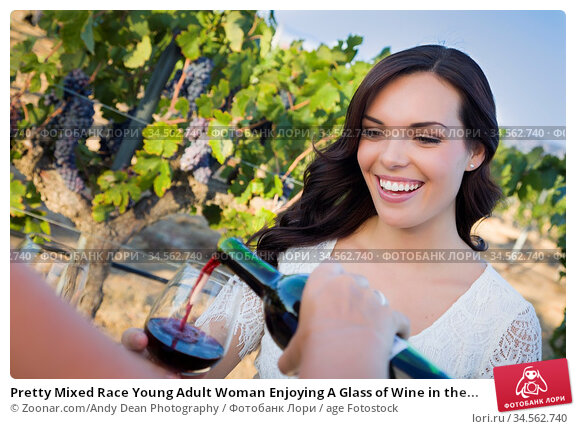 Pretty Mixed Race Young Adult Woman Enjoying A Glass of Wine in the... Стоковое фото, фотограф Zoonar.com/Andy Dean Photography / age Fotostock / Фотобанк Лори