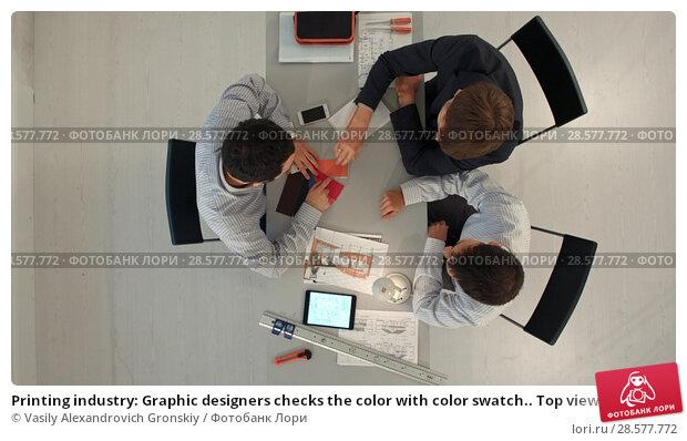 Купить «Printing industry: Graphic designers checks the color with color swatch.. Top view», фото № 28577772, снято 19 июня 2018 г. (c) Vasily Alexandrovich Gronskiy / Фотобанк Лори