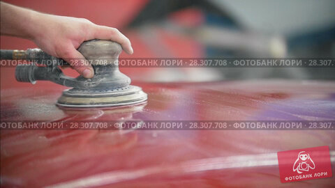 Купить «Professional car service - a worker polishes red automobile», видеоролик № 28307708, снято 26 апреля 2018 г. (c) Константин Шишкин / Фотобанк Лори