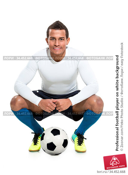 Professional football player on white background. Стоковое фото, фотограф Zoonar.com/Yeko Photo Studio / easy Fotostock / Фотобанк Лори