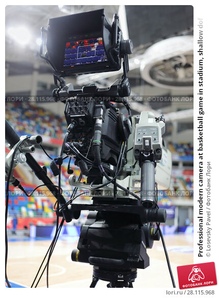 Купить «Professional modern camera at basketball game in stadium, shallow dof», фото № 28115968, снято 27 января 2017 г. (c) Losevsky Pavel / Фотобанк Лори