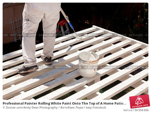 Professional Painter Rolling White Paint Onto The Top of A Home Patio... Стоковое фото, фотограф Zoonar.com/Andy Dean Photography / easy Fotostock / Фотобанк Лори