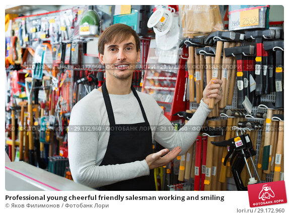 Купить «Professional young cheerful friendly salesman working and smiling», фото № 29172960, снято 20 ноября 2018 г. (c) Яков Филимонов / Фотобанк Лори