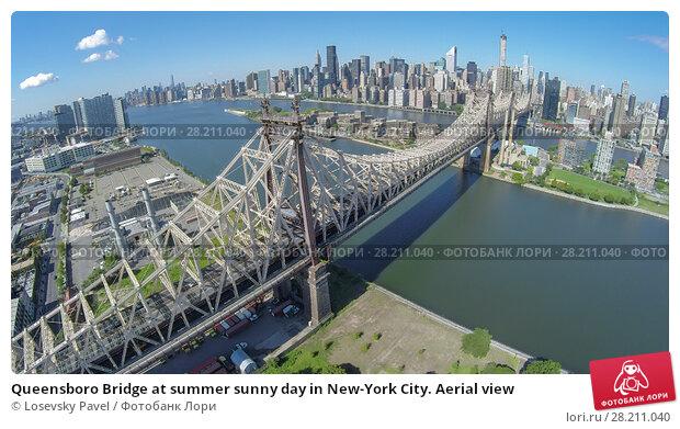 Купить «Queensboro Bridge at summer sunny day in New-York City. Aerial view», фото № 28211040, снято 19 мая 2019 г. (c) Losevsky Pavel / Фотобанк Лори