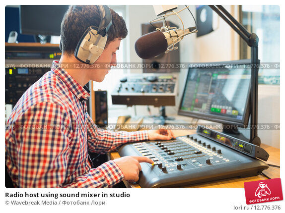 Купить «Radio host using sound mixer in studio», фото № 12776376, снято 14 июля 2015 г. (c) Wavebreak Media / Фотобанк Лори