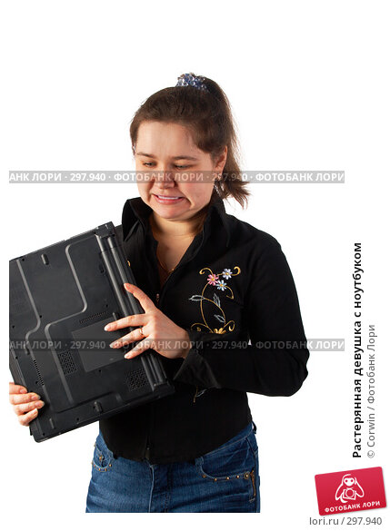 Растерянная девушка с ноутбуком, фото № 297940, снято 9 марта 2008 г. (c) Corwin / Фотобанк Лори