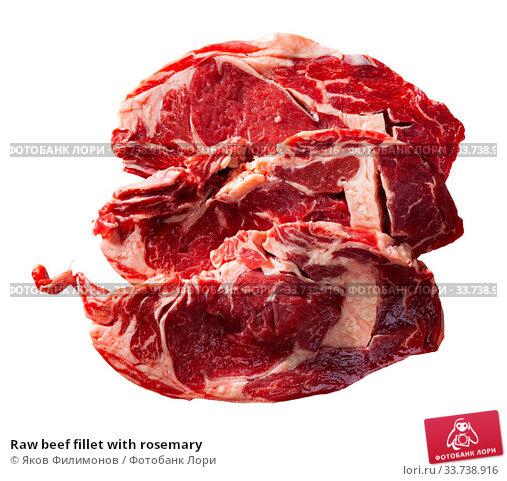 Купить «Raw beef fillet with rosemary», фото № 33738916, снято 2 июля 2020 г. (c) Яков Филимонов / Фотобанк Лори