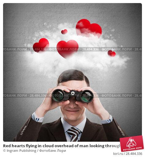 Купить «Red hearts flying in cloud overhead of man looking through binoculars. Valentine's day background», фото № 28484336, снято 21 августа 2018 г. (c) Ingram Publishing / Фотобанк Лори