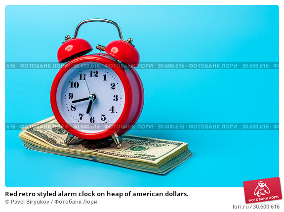 Купить «Red retro styled alarm clock on heap of american dollars.», фото № 30600616, снято 25 мая 2019 г. (c) Pavel Biryukov / Фотобанк Лори