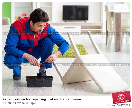 Repair contractor repairing broken chair at home. Стоковое фото, фотограф Elnur / Фотобанк Лори