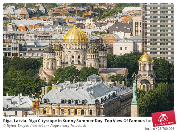 Купить «Riga, Latvia. Riga Cityscape In Sunny Summer Day. Top View Of Famous Landmarks - Riga Nativity Of Christ Cathedral And Memorial Freedom Monument.», фото № 28700096, снято 1 июля 2016 г. (c) easy Fotostock / Фотобанк Лори