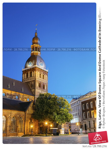 Купить «Riga, Latvia. View Of Dome Square And Dome Cathedral In Evening Illumination Under Blue Sky. Ancient Medieval Monument Of Old Town, Architectural Heritage, Famous Showplace.», фото № 28700216, снято 1 июля 2016 г. (c) easy Fotostock / Фотобанк Лори