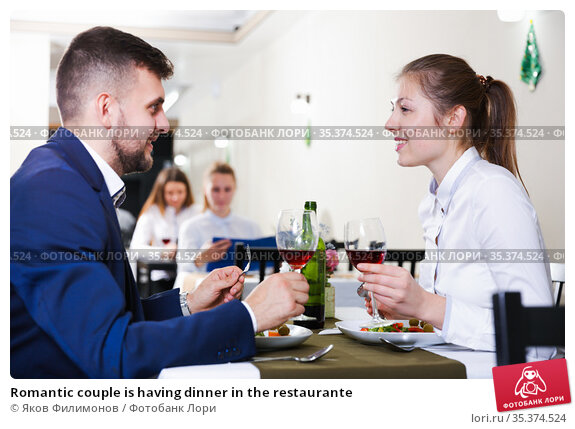 Romantic couple is having dinner in the restaurante. Стоковое фото, фотограф Яков Филимонов / Фотобанк Лори