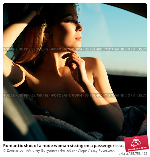Romantic shot of a nude woman sitting on a passenger seat in a car... Стоковое фото, фотограф Zoonar.com/Andrey Guryanov / easy Fotostock / Фотобанк Лори