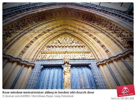 Rose window weinstmister abbey in london old church door. Стоковое фото, фотограф Zoonar.com/LKPRO / easy Fotostock / Фотобанк Лори