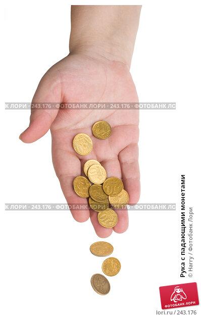 Купить «Рука с падающими монетами», фото № 243176, снято 25 ноября 2017 г. (c) Harry / Фотобанк Лори
