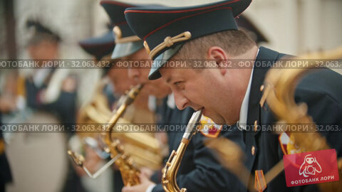 RUSSIA, KAZAN 09-08-2019: military parade - men playing saxophone at wind instrument parade. Редакционное видео, видеограф Константин Шишкин / Фотобанк Лори