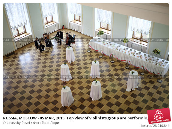 Купить «RUSSIA, MOSCOW - 05 MAR, 2015: Top view of violinists group are performing at literary award Yasnaya polyana in the Pashkov house», фото № 28210844, снято 5 марта 2015 г. (c) Losevsky Pavel / Фотобанк Лори
