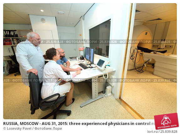 Купить «RUSSIA, MOSCOW - AUG 31, 2015: three experienced physicians in control room, and magnetic resonance imaging machine with patient in multidisciplinary Clinic Center Endosurgery and Lithotripsy (CELT)», фото № 25839828, снято 31 августа 2015 г. (c) Losevsky Pavel / Фотобанк Лори