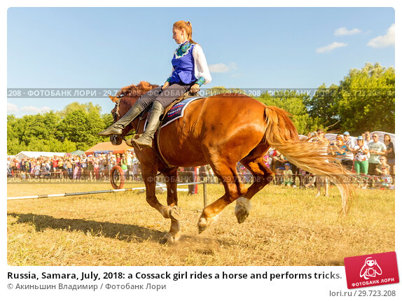 Купить «Russia, Samara, July, 2018: a Cossack girl rides a horse and performs tricks.», фото № 29723208, снято 29 июля 2018 г. (c) Акиньшин Владимир / Фотобанк Лори