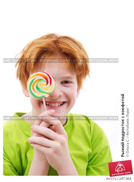 Рыжий подросток с конфетой, фото № 247964, снято 28 февраля 2008 г. (c) Ольга С. / Фотобанк Лори