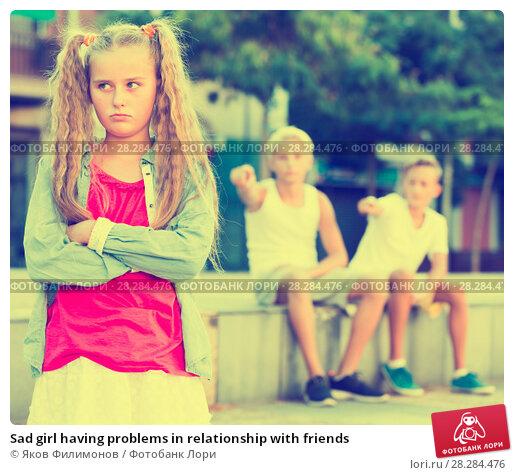 Купить «Sad girl having problems in relationship with friends», фото № 28284476, снято 27 июля 2017 г. (c) Яков Филимонов / Фотобанк Лори