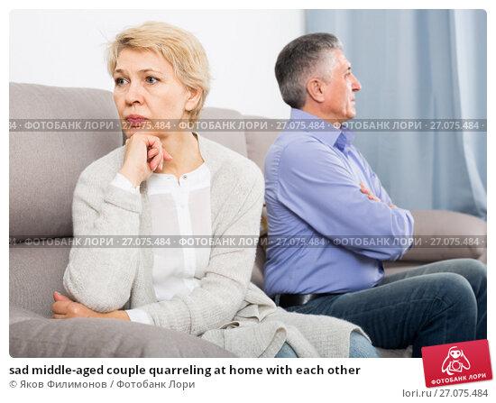 sad middle-aged couple quarreling at home with each other, фото № 27075484, снято 21 октября 2017 г. (c) Яков Филимонов / Фотобанк Лори