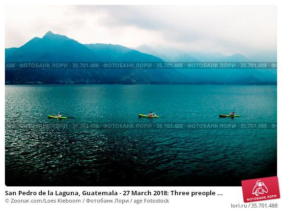 San Pedro de la Laguna, Guatemala - 27 March 2018: Three preople ... Стоковое фото, фотограф Zoonar.com/Loes Kieboom / age Fotostock / Фотобанк Лори