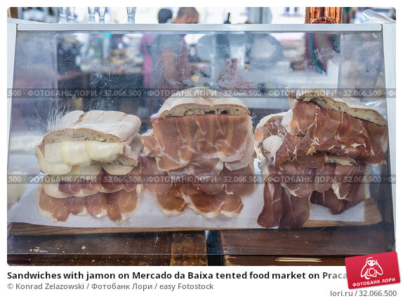 Sandwiches with jamon on Mercado da Baixa tented food market on Praca da Figueira. Стоковое фото, фотограф Konrad Zelazowski / easy Fotostock / Фотобанк Лори