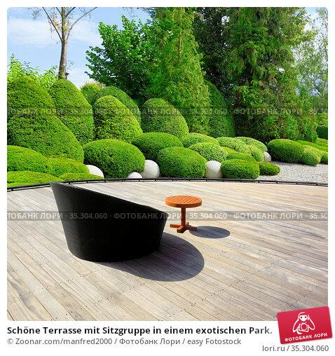 Schöne Terrasse mit Sitzgruppe in einem exotischen Park. Стоковое фото, фотограф Zoonar.com/manfred2000 / easy Fotostock / Фотобанк Лори