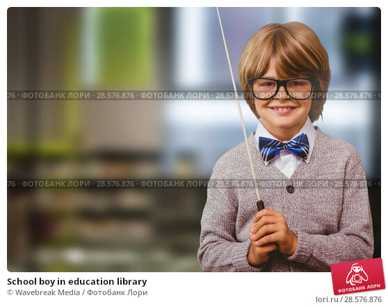 Купить «School boy in education library», фото № 28576876, снято 25 июня 2018 г. (c) Wavebreak Media / Фотобанк Лори