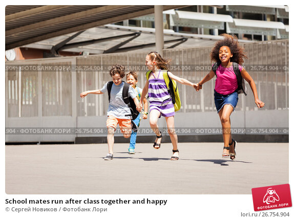 Купить «School mates run after class together and happy», фото № 26754904, снято 17 июня 2017 г. (c) Сергей Новиков / Фотобанк Лори