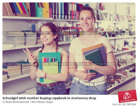 Schoolgirl with mother buying copybook in stationery shop, фото № 26760544, снято 9 мая 2017 г. (c) Яков Филимонов / Фотобанк Лори
