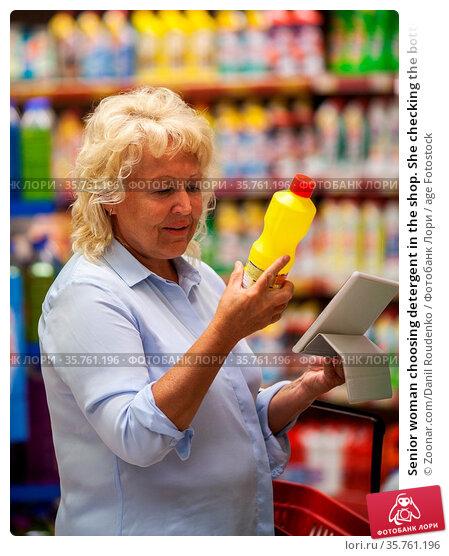 Senior woman choosing detergent in the shop. She checking the bottle... Стоковое фото, фотограф Zoonar.com/Danil Roudenko / age Fotostock / Фотобанк Лори