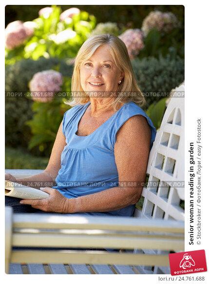 Senior woman reading in garden, фото № 24761688, снято 1 марта 2011 г. (c) easy Fotostock / Фотобанк Лори