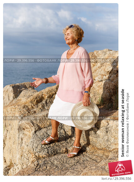 Купить «Senior woman relaxing at seaside», фото № 29396556, снято 6 июля 2018 г. (c) Яков Филимонов / Фотобанк Лори