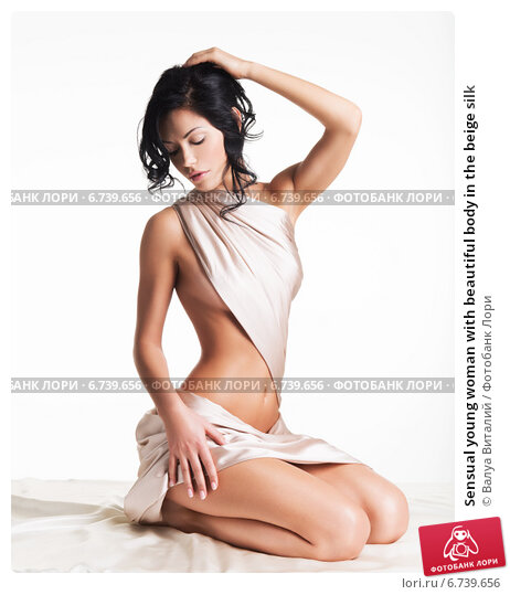 Купить «Sensual young woman with beautiful body in the beige silk», фото № 6739656, снято 16 января 2014 г. (c) Валуа Виталий / Фотобанк Лори