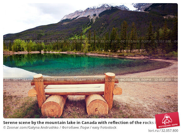 Serene scene by the mountain lake in Canada with reflection of the rocks in the calm water. Стоковое фото, фотограф Zoonar.com/Galyna Andrushko / easy Fotostock / Фотобанк Лори