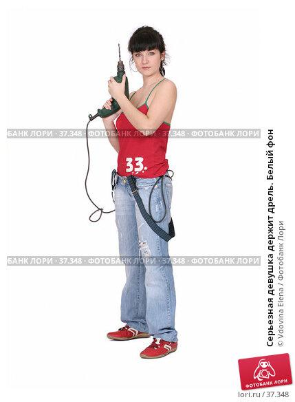 Купить «Серьезная девушка держит дрель. Белый фон», фото № 37348, снято 31 марта 2007 г. (c) Vdovina Elena / Фотобанк Лори