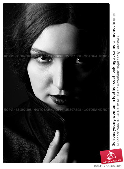 Serious young woman in leather coat looking at camera, monochrome. Стоковое фото, фотограф Zoonar.com/TUGOLUKOV ALEKSEY / easy Fotostock / Фотобанк Лори