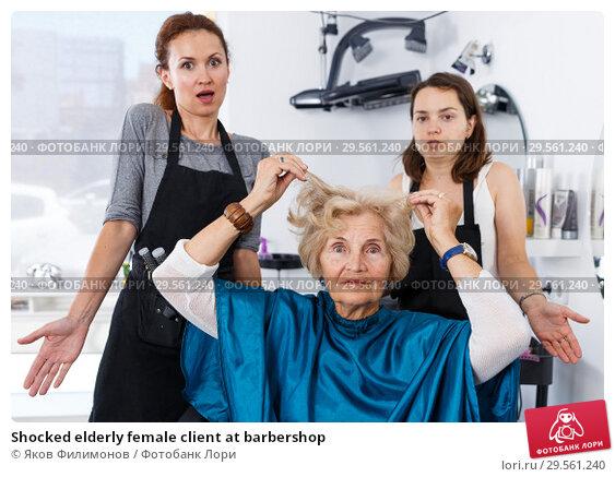 Купить «Shocked elderly female client at barbershop», фото № 29561240, снято 26 июня 2018 г. (c) Яков Филимонов / Фотобанк Лори
