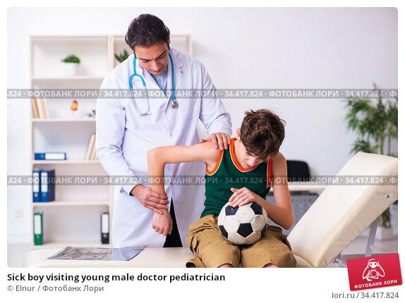 Sick boy visiting young male doctor pediatrician. Стоковое фото, фотограф Elnur / Фотобанк Лори