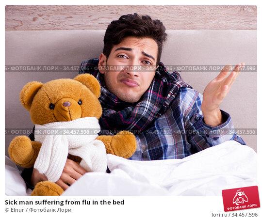 Sick man suffering from flu in the bed. Стоковое фото, фотограф Elnur / Фотобанк Лори