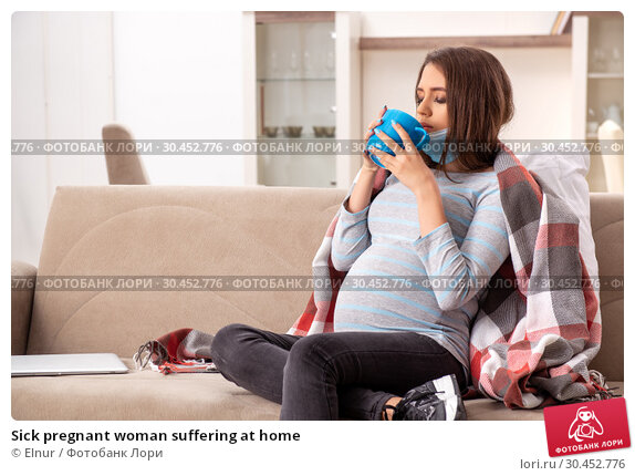 Sick pregnant woman suffering at home. Стоковое фото, фотограф Elnur / Фотобанк Лори