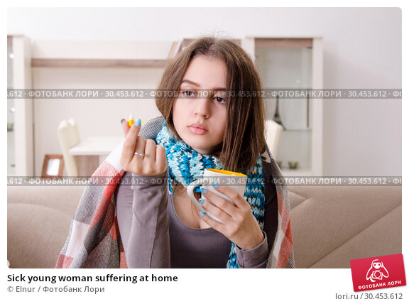 Sick young woman suffering at home. Стоковое фото, фотограф Elnur / Фотобанк Лори