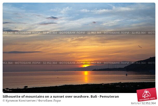 Silhouette of mountains on a sunset over seashore. Bali - Pemuteran (2017 год). Стоковое фото, фотограф Куликов Константин / Фотобанк Лори