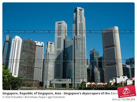 Singapore, Republic of Singapore, Asia - Singapore's skyscrapers of the Central Business District at Raffles Place tower the historic buildings along the Singapore River around Boat Quay. Стоковое фото, фотограф Olaf Schuelke / age Fotostock / Фотобанк Лори