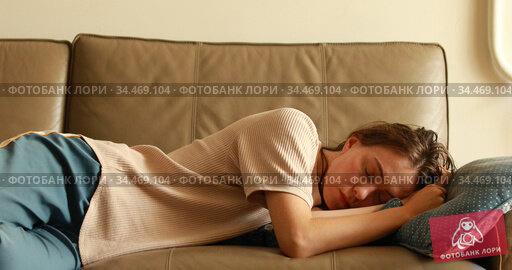 sleepy woman falls down on sofa. Стоковое видео, видеограф Ekaterina Demidova / Фотобанк Лори