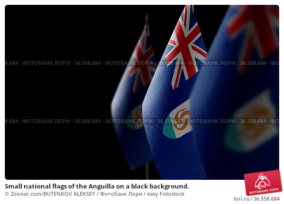 Small national flags of the Anguilla on a black background. Стоковое фото, фотограф Zoonar.com/BUTENKOV ALEKSEY / easy Fotostock / Фотобанк Лори